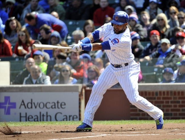 Apr 18, 2014; Chicago, IL, USA; Chicago Cubs second baseman Emilio Bonifacio (64) hits a single against the Cincinnati Reds during the first inning at Wrigley Field. Mandatory Credit: David Banks-USA TODAY Sports
