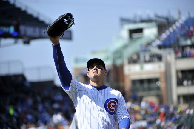 Apr 18, 2014; Chicago, IL, USA; Chicago Cubs first baseman Anthony Rizzo (44) looks into the stands for a foul ball during the second inning of a game against the Cincinnati Reds at Wrigley Field. Mandatory Credit: David Banks-USA TODAY Sports