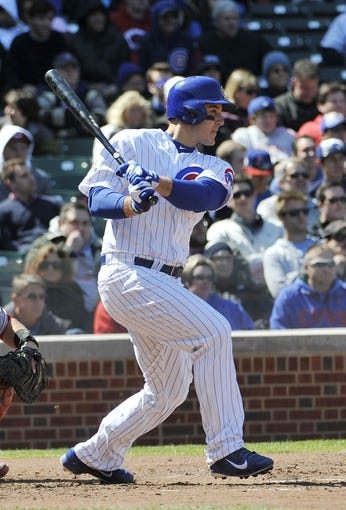 Apr 18, 2014; Chicago, IL, USA; Chicago Cubs first baseman Anthony Rizzo (44) hits a single against the Cincinnati Reds during the fourth inning at Wrigley Field. Mandatory Credit: David Banks-USA TODAY Sports