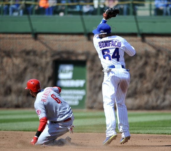 Apr 18, 2014; Chicago, IL, USA; Cincinnati Reds center fielder Billy Hamilton (6) slides safely into second base with an RBI double as Chicago Cubs second baseman Emilio Bonifacio (64) takes the throw during the fifth inning at Wrigley Field. Mandatory Credit: David Banks-USA TODAY Sports