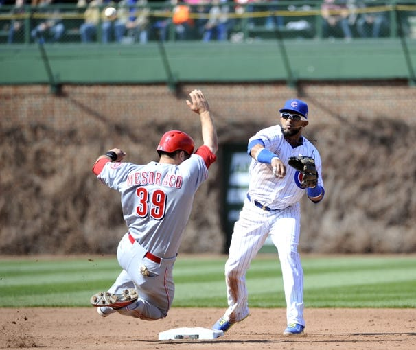 Apr 18, 2014; Chicago, IL, USA; Cincinnati Reds catcher Devin Mesoraco (39) is forced out by Chicago Cubs shortstop Emilio Bonifacio (64) during the sixth inning at Wrigley Field. Mandatory Credit: David Banks-USA TODAY Sports