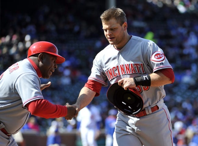 Apr 18, 2014; Chicago, IL, USA;  Cincinnati Reds catcher Devin Mesoraco (right) is greeted by  first base coach Billy Hatcher (22) after breaking up a double play against the Chicago Cubs during the sixth inningat Wrigley Field. Mandatory Credit: David Banks-USA TODAY Sports