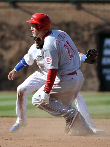 Apr 18, 2014; Chicago, IL, USA;  Cincinnati Reds third baseman Todd Frazier (21) steals second base as Chicago Cubs second baseman Emilio Bonifacio (64)  makes a late tag during the eighth inning at Wrigley Field. Mandatory Credit: David Banks-USA TODAY Sports