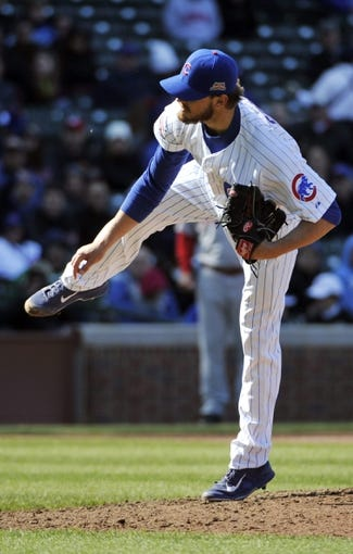 Apr 18, 2014; Chicago, IL, USA;  Chicago Cubs relief pitcher Justin Grimm (52) pitches against the Chicago Cubs during the eighth inning at Wrigley Field. Mandatory Credit: David Banks-USA TODAY Sports