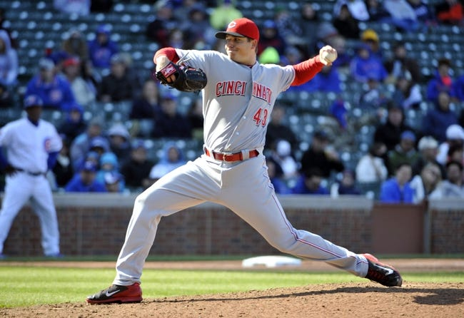 Apr 18, 2014; Chicago, IL, USA; Cincinnati Reds relief pitcher Manny Parra (43) pitches against the Chicago Cubs during the eighth inning at Wrigley Field. Mandatory Credit: David Banks-USA TODAY Sports