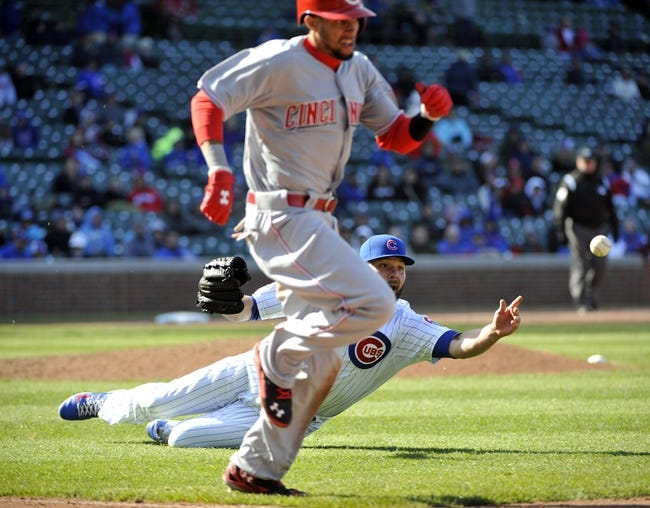 Apr 18, 2014; Chicago, IL, USA; Chicago Cubs relief pitcher James Russell (40) throws out Cincinnati Reds center fielder Billy Hamilton (6) at first base during the ninth inning at Wrigley Field. Mandatory Credit: David Banks-USA TODAY Sports