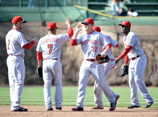 Apr 18, 2014; Chicago, IL, USA; The Cincinnati Reds celebrate their win against the Chicago Cubs at Wrigley Field. The Cincinnati Reds defeated the Chicago Cubs 4-1. Mandatory Credit: David Banks-USA TODAY Sports