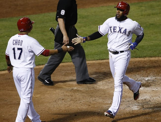 Apr 18, 2014; Arlington, TX, USA; Texas Rangers shortstop Elvis Andrus (1) celebrates with left fielder Shin-Soo Choo (17) after scoring a run against the Chicago White Sox during the third inning of a baseball game at Rangers Ballpark in Arlington. Mandatory Credit: Jim Cowsert-USA TODAY Sports