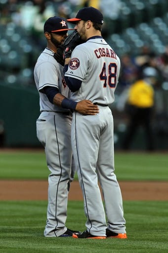 Apr 18, 2014; Oakland, CA, USA;  Houston Astros shortstop Jonathan Villar (6) talks with starting pitcher Jarred Cosart (48) in the first inning of their baseball game with the Oakland Athletics at O.co Coliseum. Mandatory Credit: Lance Iversen-USA TODAY Sports