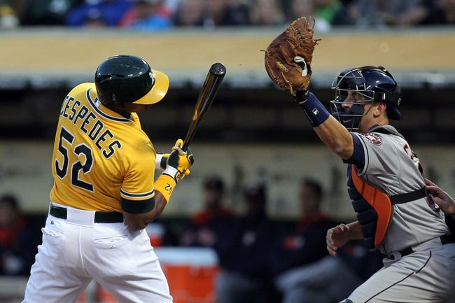 Apr 18, 2014; Oakland, CA, USA; Oakland Athletics Yoenis Cespedes (52) is brushed back by Houston Astros starting pitcher Jarred Cosart (not pictured) in the first inning of their baseball game at O.co Coliseum. Mandatory Credit: Lance Iversen-USA TODAY Sports