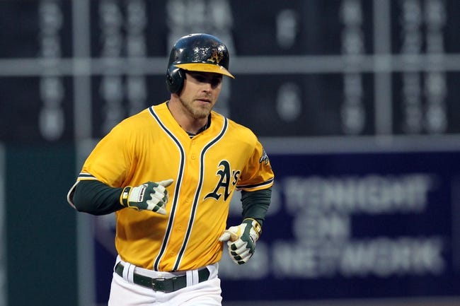 Apr 18, 2014; Oakland, CA, USA; Oakland Athletics right fielder Josh Reddick (16) rounds third base after hitting a two run homer against the Houston Astros in the first inning of their baseball game at O.co Coliseum. Mandatory Credit: Lance Iversen-USA TODAY Sports