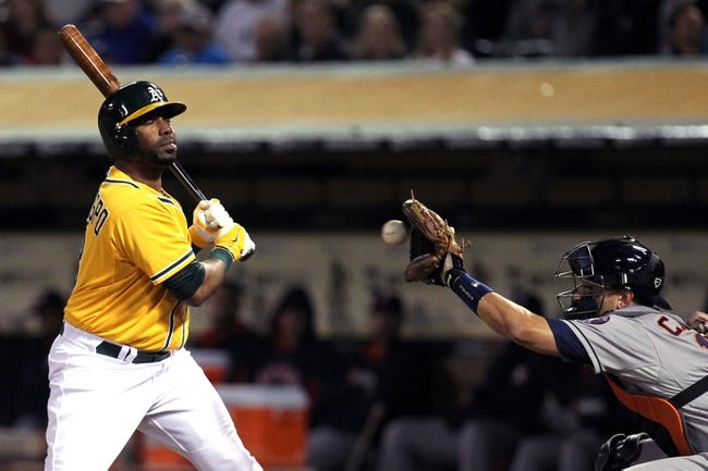 Apr 18, 2014; Oakland, CA, USA; Oakland Athletics DH Alberto Callaspo (18) is brushed back in the third inning during their baseball game with the Houston Astros at O.co Coliseum. Mandatory Credit: Lance Iversen-USA TODAY Sports