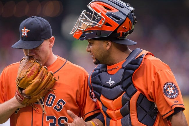 Apr 13, 2014; Arlington, TX, USA; Houston Astros starting pitcher Brett Oberholtzer (39) and Houston Astros catcher Carlos Corporan (22) during the game at Globe Life Park in Arlington. The Rangers defeated the Astros 1-0. Mandatory Credit: Jerome Miron-USA TODAY Sports