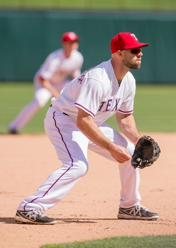 Apr 13, 2014; Arlington, TX, USA; Texas Rangers third baseman Kevin Kouzmanoff (6) during the game against the Houston Astros at Globe Life Park in Arlington. The Rangers defeated the Astros 1-0. Mandatory Credit: Jerome Miron-USA TODAY Sports