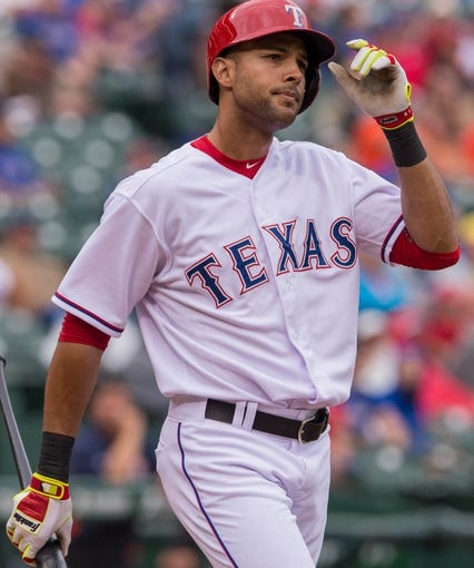 Apr 13, 2014; Arlington, TX, USA; Texas Rangers right fielder Alex Rios (51) during the game against the Houston Astros at Globe Life Park in Arlington. The Rangers defeated the Astros 1-0. Mandatory Credit: Jerome Miron-USA TODAY Sports