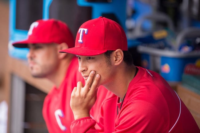 Apr 13, 2014; Arlington, TX, USA; Texas Rangers starting pitcher Yu Darvish (11) during the game against the Houston Astros at Globe Life Park in Arlington. The Rangers defeated the Astros 1-0. Mandatory Credit: Jerome Miron-USA TODAY Sports