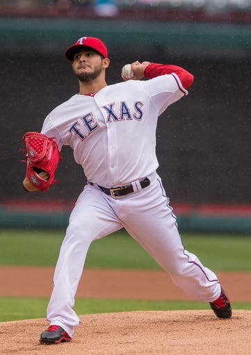 Apr 13, 2014; Arlington, TX, USA; Texas Rangers starting pitcher Martin Perez (33) during the game against the Houston Astros at Globe Life Park in Arlington. The Rangers defeated the Astros 1-0. Mandatory Credit: Jerome Miron-USA TODAY Sports