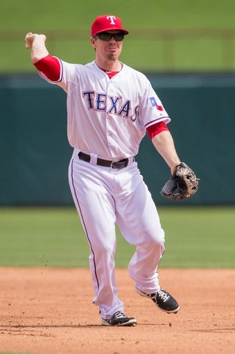 Apr 13, 2014; Arlington, TX, USA; Texas Rangers second baseman Josh Wilson (12) during the game against the Houston Astros at Globe Life Park in Arlington. The Rangers defeated the Astros 1-0. Mandatory Credit: Jerome Miron-USA TODAY Sports