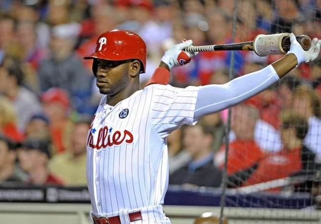 Apr 14, 2014; Philadelphia, PA, USA; Philadelphia Phillies left fielder Domonic Brown (9) loosens up against the Atlanta Braves at Citizens Bank Park. The Braves defeated the Phillies, 9-6. Mandatory Credit: Eric Hartline-USA TODAY Sports