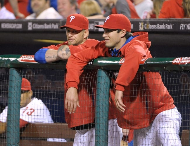 Apr 14, 2014; Philadelphia, PA, USA; Philadelphia Phillies starting pitcher A.J. Burnett (34) and starting pitcher Jonathan Pettibone (44) watch game against the Atlanta Braves from the dugout at Citizens Bank Park. The Braves defeated the Phillies, 9-6. Mandatory Credit: Eric Hartline-USA TODAY Sports