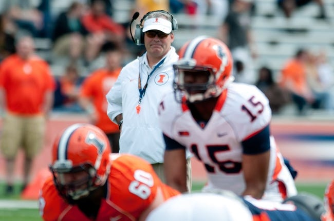 Apr 12, 2014; Champaign, IL, USA;  Illinois Fighting Illini head coach Tim Beckman watches as Illinois Fighting Illini quarterback Aaron Bailey (15) prepares to take a snap from Illinois Fighting Illini center Tony Durkin (60) during the spring game at Memorial Stadium. Mandatory Credit: Bradley Leeb-USA TODAY Sports