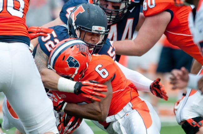 Apr 12, 2014; Champaign, IL, USA;  Illinois Fighting Illini linebacker T.J. Neal (52) tackles Illinois Fighting Illini running back Josh Ferguson during the spring game at Memorial Stadium. Mandatory Credit: Bradley Leeb-USA TODAY Sports