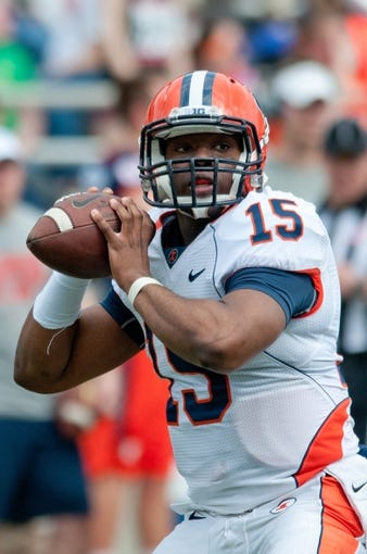 Apr 12, 2014; Champaign, IL, USA;  Illinois Fighting Illini quarterback Aaron Bailey (15) throws a pass during the spring game at Memorial Stadium. Mandatory Credit: Bradley Leeb-USA TODAY Sports