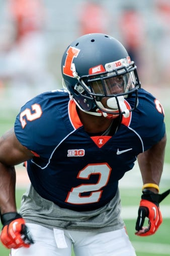 Apr 12, 2014; Champaign, IL, USA;  Illinois Fighting Illini defensive back V'Angelo Bentley warms up before the spring game at Memorial Stadium. Mandatory Credit: Bradley Leeb-USA TODAY Sports