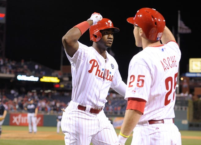 Apr 14, 2014; Philadelphia, PA, USA; Philadelphia Phillies left fielder Domonic Brown (9) celebrates his three run home run with Philadelphia Phillies third baseman Cody Asche (25) against the Atlanta Braves at Citizens Bank Park. The Braves defeated the Phillies, 9-6. Mandatory Credit: Eric Hartline-USA TODAY Sports