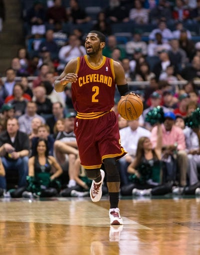 Apr 11, 2014; Milwaukee, WI, USA; Cleveland Cavaliers guard Kyrie Irving (2) during the game against the Milwaukee Bucks at BMO Harris Bradley Center.  Milwaukee won 119-116.  Mandatory Credit: Jeff Hanisch-USA TODAY Sports