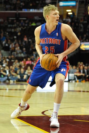 Apr 9, 2014; Cleveland, OH, USA; Detroit Pistons forward Kyle Singler (25) drives against the Cleveland Cavaliers  at Quicken Loans Arena. Cleveland won 122-100. Mandatory Credit: David Richard-USA TODAY Sports