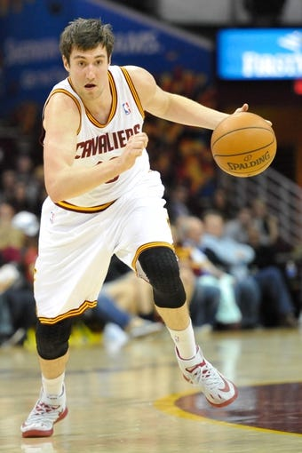 Apr 9, 2014; Cleveland, OH, USA; Cleveland Cavaliers guard Sergey Karasev (10) dribbles against the Detroit Pistons at Quicken Loans Arena. Cleveland won 122-100. Mandatory Credit: David Richard-USA TODAY Sports