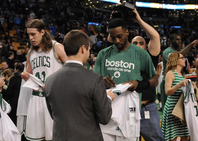 Apr 16, 2014; Boston, MA, USA; Boston Celtics forward Jeff Green (8) signs an autograph after the game against the Washington Wizards at TD Garden. Mandatory Credit: Bob DeChiara-USA TODAY Sports