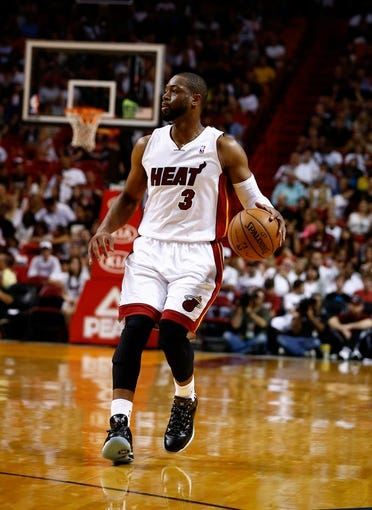 Apr 16, 2014; Miami, FL, USA; Miami Heat guard Dwyane Wade (3) dribbles the ball in the second half of a game against the Philadelphia 76ers at American Airlines Arena. The 76ers won 100-87. Mandatory Credit: Robert Mayer-USA TODAY Sports
