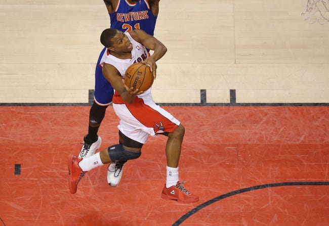 Apr 11, 2014; Toronto, Ontario, CAN; Toronto Raptors point guard Kyle Lowry (7) is fouled as he goes to the basket against the New York Knicks at Air Canada Centre. The Knicks beat the Raptors 108-100. Mandatory Credit: Tom Szczerbowski-USA TODAY Sports