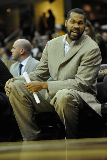 Apr 9, 2014; Cleveland, OH, USA; Detroit Pistons player development coach Rasheed Wallace sits on the bench against the Cleveland Cavaliers at Quicken Loans Arena. Cleveland won 122-100. Mandatory Credit: David Richard-USA TODAY Sports