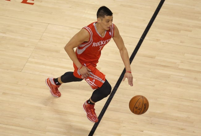 Apr 2, 2014; Toronto, Ontario, CAN; Houston Rockets guard Jeremy Lin (7) dribbles against the Toronto Raptors at Air Canada Centre. The Raptors beat the Rockets 107-103. Mandatory Credit: Tom Szczerbowski-USA TODAY Sports