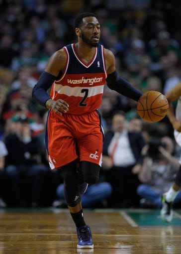 Apr 16, 2014; Boston, MA, USA; Washington Wizards guard John Wall (2) dribbles the ball during the second half against the Boston Celtics at TD Garden. Mandatory Credit: Bob DeChiara-USA TODAY Sports