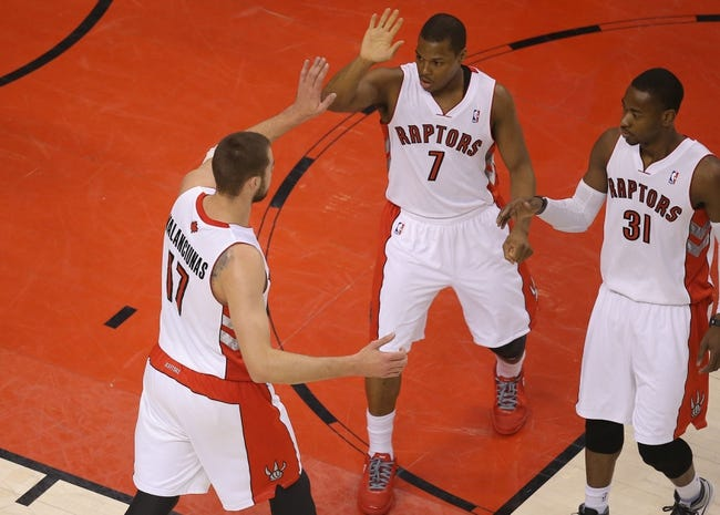 Apr 11, 2014; Toronto, Ontario, CAN; Toronto Raptors center Jonas Valanciunas (17) celebrates a basket with point guard Kyle Lowry (7) and guard Terrence Ross (31) against the New York Knicks at Air Canada Centre. The Knicks beat the Raptors 108-100. Mandatory Credit: Tom Szczerbowski-USA TODAY Sports
