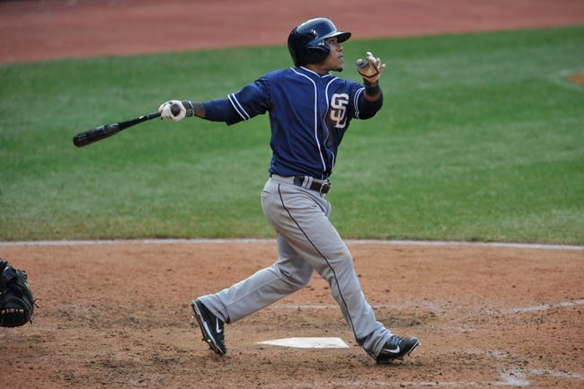Apr 9, 2014; Cleveland, OH, USA; San Diego Padres second baseman Alexi Amarista (5) bats against the Cleveland Indians in game two at Progressive Field. San Diego won 2-1. Mandatory Credit: David Richard-USA TODAY Sports