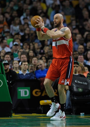 Apr 16, 2014; Boston, MA, USA; Washington Wizards center Marcin Gortat (4) grabs a rebound during the second half against the Boston Celtics at TD Garden. Mandatory Credit: Bob DeChiara-USA TODAY Sports