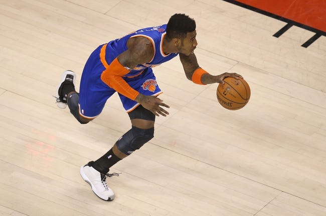 Apr 11, 2014; Toronto, Ontario, CAN; New York Knicks forward Iman Shumpert (21) dribbles out of his half of the court against the Toronto Raptors at Air Canada Centre. The Knicks beat the Raptors 108-100. Mandatory Credit: Tom Szczerbowski-USA TODAY Sports