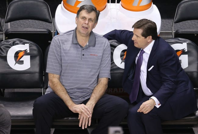 Apr 2, 2014; Toronto, Ontario, CAN; Houston Rockets head coach Kevin McHale does an interview with Sportsnet reporter Matt Devlin before the game against the Toronto Raptors at Air Canada Centre. The Raptors beat the Rockets 107-103. Mandatory Credit: Tom Szczerbowski-USA TODAY Sports