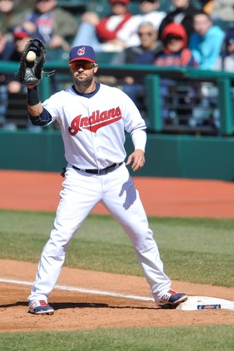 Apr 9, 2014; Cleveland, OH, USA; Cleveland Indians first baseman Nick Swisher (33) takes a throw against the San Diego Padres in game two at Progressive Field. San Diego won 2-1. Mandatory Credit: David Richard-USA TODAY Sports