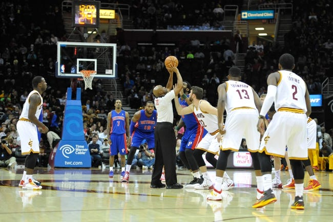 Apr 9, 2014; Cleveland, OH, USA; NBA referee Tre Maddox (73) prepares to throw up a jump ball prior to a game between the Cleveland Cavaliers and the Detroit Pistons at Quicken Loans Arena. Cleveland won 122-100. Mandatory Credit: David Richard-USA TODAY Sports