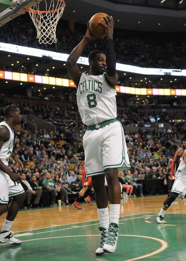 Apr 16, 2014; Boston, MA, USA; Boston Celtics forward Jeff Green (8) grabs a rebound during the first half against the Washington Wizards at TD Garden. Mandatory Credit: Bob DeChiara-USA TODAY Sports