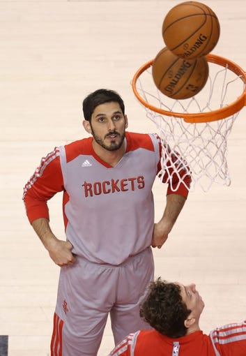 Apr 2, 2014; Toronto, Ontario, CAN; Houston Rockets forward Omri Casspi (18) warms up before playing against teh Toronto Raptors at Air Canada Centre. The Raptors beat the Rockets 107-103. Mandatory Credit: Tom Szczerbowski-USA TODAY Sports