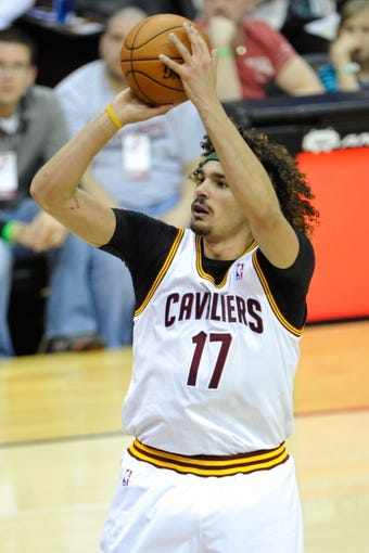 Apr 9, 2014; Cleveland, OH, USA; Cleveland Cavaliers center Anderson Varejao (17) shoots against the Detroit Pistons at Quicken Loans Arena. Cleveland won 122-100. Mandatory Credit: David Richard-USA TODAY Sports