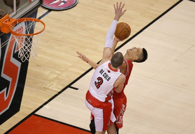 Apr 2, 2014; Toronto, Ontario, CAN; Houston Rockets guard Jeremy Lin (7) is fouled by Toronto Raptors guard Nando De Colo (3) at Air Canada Centre. The Raptors beat the Rockets 107-103. Mandatory Credit: Tom Szczerbowski-USA TODAY Sports