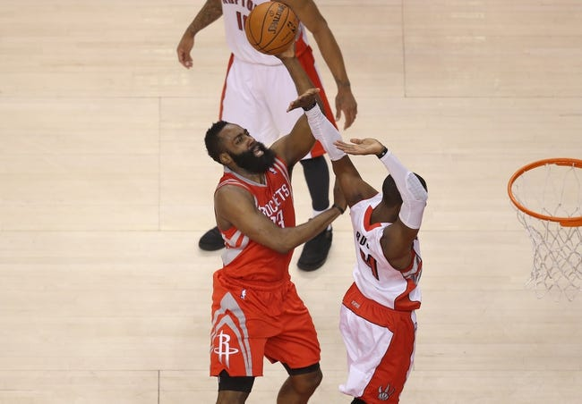 Apr 2, 2014; Toronto, Ontario, CAN; Houston Rockets guard James Harden (13) scores a basket and is fouled as he goes to the hoop against the Toronto Raptors at Air Canada Centre. The Raptors beat the Rockets 107-103. Mandatory Credit: Tom Szczerbowski-USA TODAY Sports